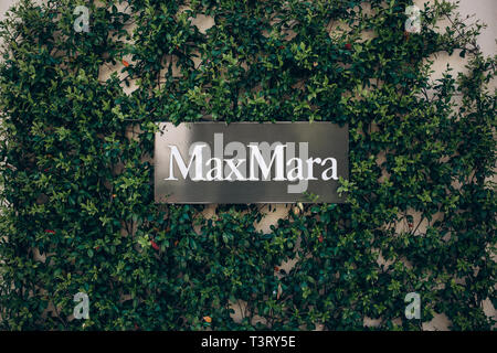Montenegro, Tivat, April 9, 2019: Street sign at the entrance to the MaxMara shop. Italian brand and fashion store of clothes and perfumery. - Stock Image