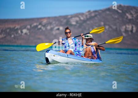 Couple kayaking in the Langebaan Lagoon in the West Coast National Park - Stock Image