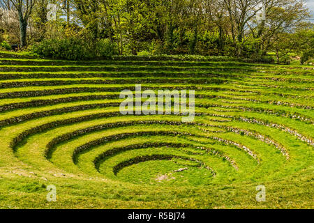 Gwennap Pit in Cornwall is a natural amphitheatre formed from an old mining pit. It was used on several occasions by John Wesley as an outdoor preachi - Stock Image