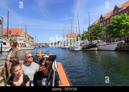 Tourists' sightseeing cruise boat on the Christianshavns Kanal, Overgaden, Christianshavn, Copenhagen, Zealand, - Stock Image