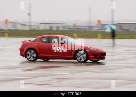 A 2004 Red Mazda RX-8 in an autocross race at a regional Sports Car Club of America (SCCA) event - Stock Image