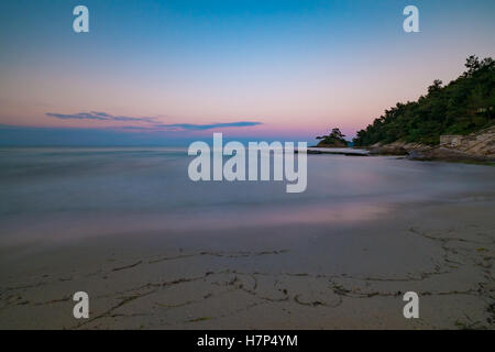 Long exposure of a beach at sunset. - Stock Image