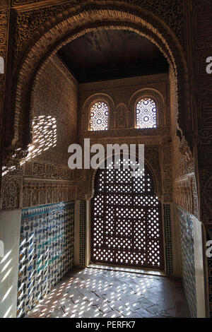 decorative window grill creating a pattern of light at the Alhambra Palace in Granada Spain - Stock Image