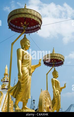 Thailand, Nakhon Phanom, Nakhon Phanom.  Buddha statues at Wat Maha That.  The Wat is home to the Phra That Nakhon - Stock Image