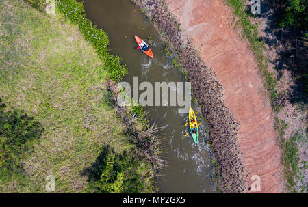 A drone image taken of two kayakers on a river in Thailand - Stock Image