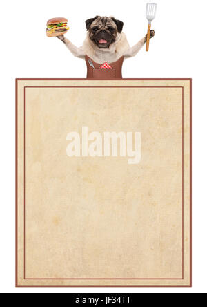 happy pug dog wearing leather bbq apron, holding hamburger and spatula, with old vintage paper menu card, isolated - Stock Image