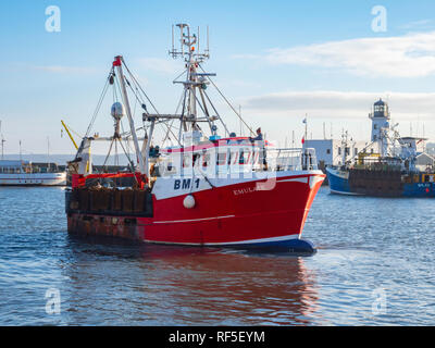 Emulate a scallop fishing boats from Brixham departing from the Fish Quay in Scarborough Harbour North Yorkshire England UK - Stock Image