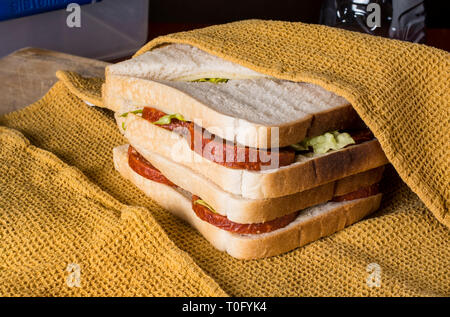 Sandwiches being wrapped in a cloth - Stock Image
