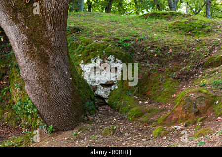 Etruscan Necropolis, sculpture of human face, Sorano, Province of Grosseto, Tuscany, Italy - Stock Image