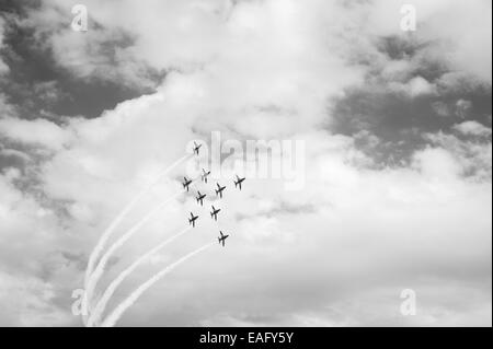 Red Arrows flying display at Malta International Airshow 2014, Flanker Bend approaching - Stock Image