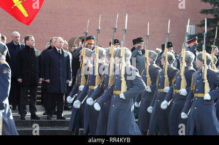 Moscow, Russia. 23rd Feb, 2019. Russian President Vladimir Putin and Prime Minister Dmitry Medvedev attend a wreath ceremony at the Tomb of the Unknown Soldier at the Kremlin Wall to honour the memory of fallen soldiers on Defender of the Fatherland Day February 23, 2019 in Moscow, Russia. Credit: Planetpix/Alamy Live News - Stock Image