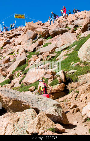 Runners compete in a rugged race up 14,115 foot Pikes Peak on the Barr Trail near Manitou Avenue in Manitou Springs - Stock Image