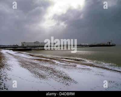 Brighton, East Sussex, UK. 12th March 2013. Brighton beach and pier. After a night of chaos on the roads caused - Stock Image