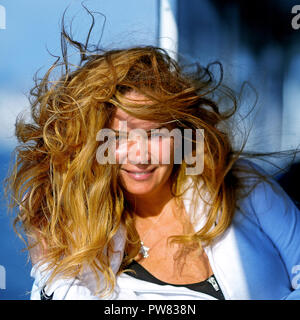 Beautiful lady with long hairs in windy day - Stock Image
