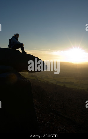sunset on a grtistone edge in the Peak District National Park Derbyshire - Stock Image