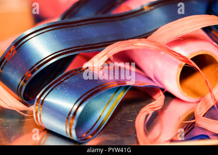 color ribbon with bow on wood table background . close up - Stock Image