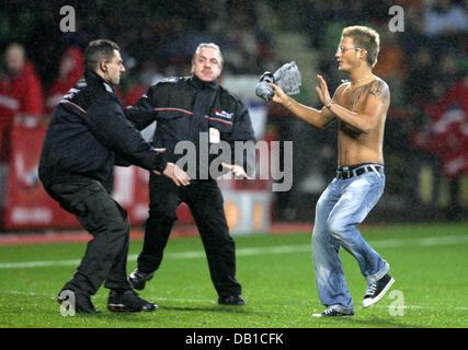 A streaker is caught by security personnel during the UEFA Cup group E match Bayer Leverkusen v Sparta Praha at - Stock Image