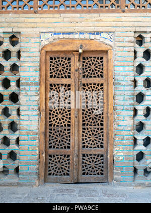Old wooden carved door at Shah mosque, Isfahan, Iran - Stock Image