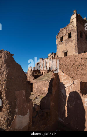 The walls of an abandoned fort in Telouet slowly crumble and decay back into the surrounding desert - Stock Image