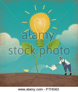 Farmer watering light bulb plant - Stock Image
