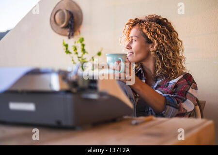 Hipster people enjoy the outdoor leisure working activity outdoor in alternative office workstation with old typwriter - no stress people work free -  - Stock Image