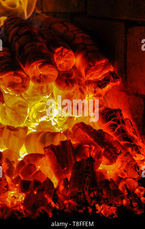 Burning embers in a very hot oven - Stock Image