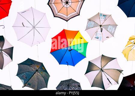 Zurich, Switzerland - March 2017: Art installation with suspended multiple colored umbrellas in Kreis 5 district of Zurich, Switzerland - Stock Image