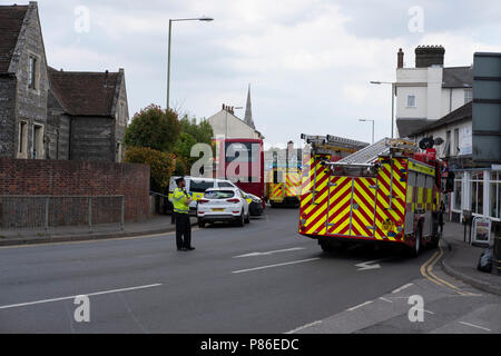 Salisbury, Wiltshire, UK. 9th July 2018. UPDATE incident was due to a man collapsing at a bus stop. The incident caused a quick response from emergency services and roads were closed causing traffic chaos for several hours. A bus has been cordoned off by police in Salisbury city centre. Its unclear at the moment if this is due to the nerve agent Novichok. But emergency staff are wearing protected white suits and gas masks. Credit Paul Chambers Alamy / Live News - Stock Image