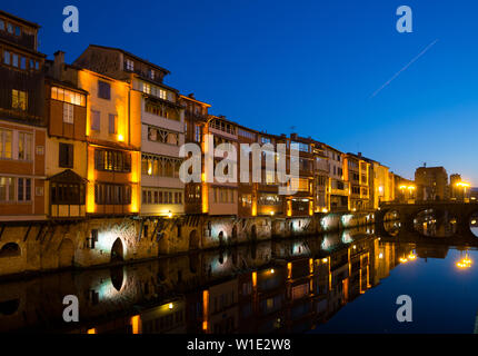 Evening view of river bank with old houses of Castres city, France - Stock Image