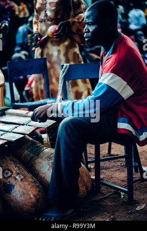 Black man playing xylophone. Multi Ethnic music party to celebrate western and developing countries cooperation. Bamako, Mali. Africa - Stock Image