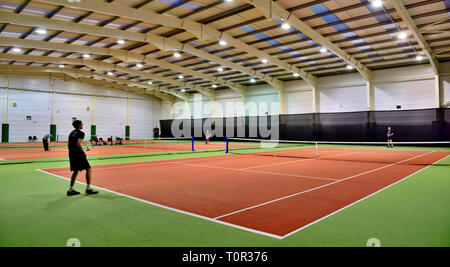 Indoor tennis courts one of many activities at Manor House Hotel, Devan, UK - Stock Image