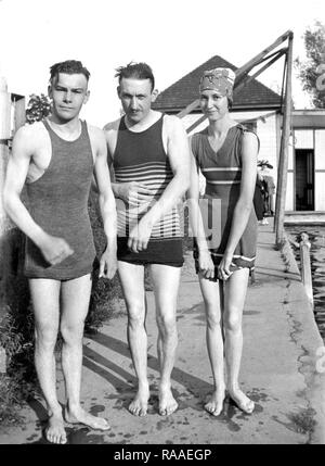 A trio of young adults pose in their period swimwear, ca. 1928. - Stock Image