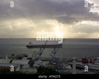 Sunset, dusk over the Bay of Gibraltar, shipyard shipyards sunset sunsets dusk evening nightfall  Gibraltar Harbour , Gibraltar - Stock Image