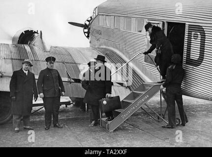 A Junkers Ju52 is received by customs officials after landing at Berlin Tempelhof Airport. - Stock Image
