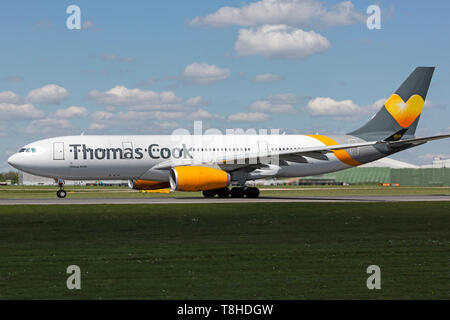 Thomas Cook Airlines Airbus A330, registration OY-VKF, taking off from Manchester Airport, England. - Stock Image