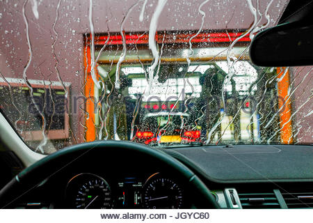 Car going through carwash street - Stock Image