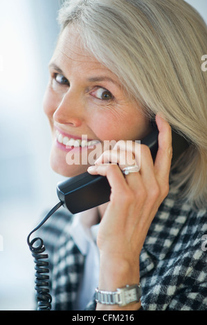 USA, New Jersey, Jersey City, Portrait of senior businesswoman talking on phone - Stock Image