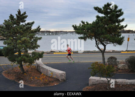 Branford, CT USA --A runner makes his way along Branford Point late Monday afternoon. - Stock Image