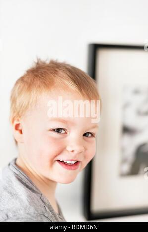Portrait of smiling boy - Stock Image
