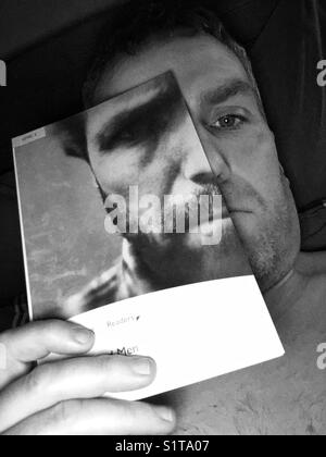 Half book, half man. - Stock Image