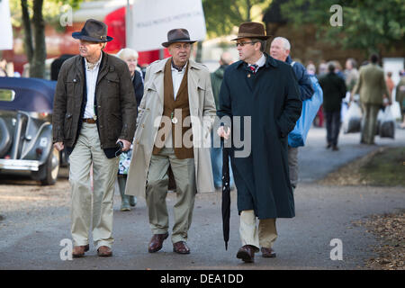 Chichester, West Sussex, UK. 14th Sep, 2013. Goodwood Revival. Goodwood Racing Circuit, West Sussex - Saturday 14th September. Three male visitors, dressed in period clothing, walk along one of the pathways around the circuit. Credit:  MeonStock/Alamy Live News - Stock Image