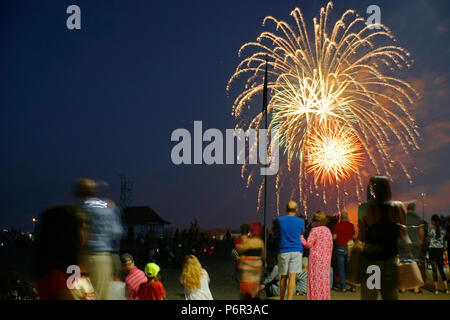 Toronto, Canada. 1st July 2018. People watching firework display in front of historic  Boat House and Lifeguard Station on the Beach in Toronto on Canada Day, July 1, 2018 Credit: CharlineXia/Alamy Live News - Stock Image