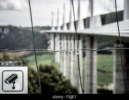 The fence, seven towers and the road deck of the Millau Viaduct in Millau, Averyron, France. The highest bridge - Stock Image