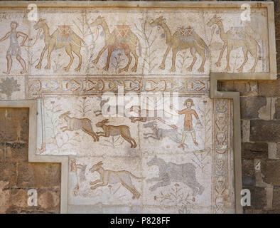 Syria. Bosra (Busra al-Sham). Daraa District. Roman mosaic, 6th century, discovered in the Theatre. Scene of camel caravan and hunting (dogs chasing hare). - Stock Image