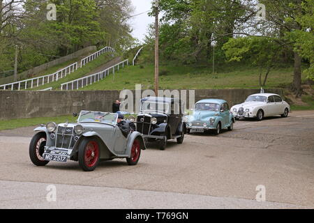 Cars arriving down Campbell Hill, British Marques Day, 28 April 2019, Brooklands Museum, Weybridge, Surrey, England, Great Britain, UK, Europe - Stock Image