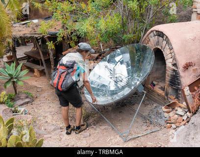 Parabolic solar cooker in hippy commune in Spain - Stock Image