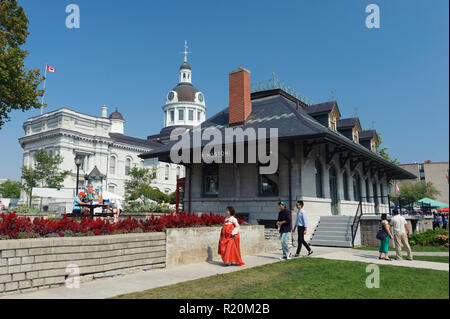 Kingston tourist information center, located in an old train station, and City Hall in the background. Ontario, Canada. - Stock Image