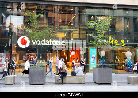 Vodafone and Yes Optus stores, competitors in data and phones, beside each other in Sydney george street,New South Wales,Australia - Stock Image