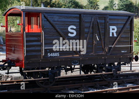 Restored vintage guard's van on the West Somerset Railway (WSR) at Williton Station. - Stock Image