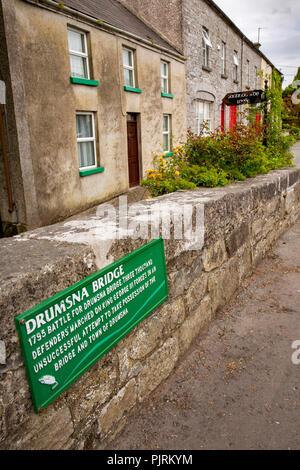 Ireland, Co Leitrim, Drumsna, 1795 battle plaque on old stone bridge across River Shannon - Stock Image